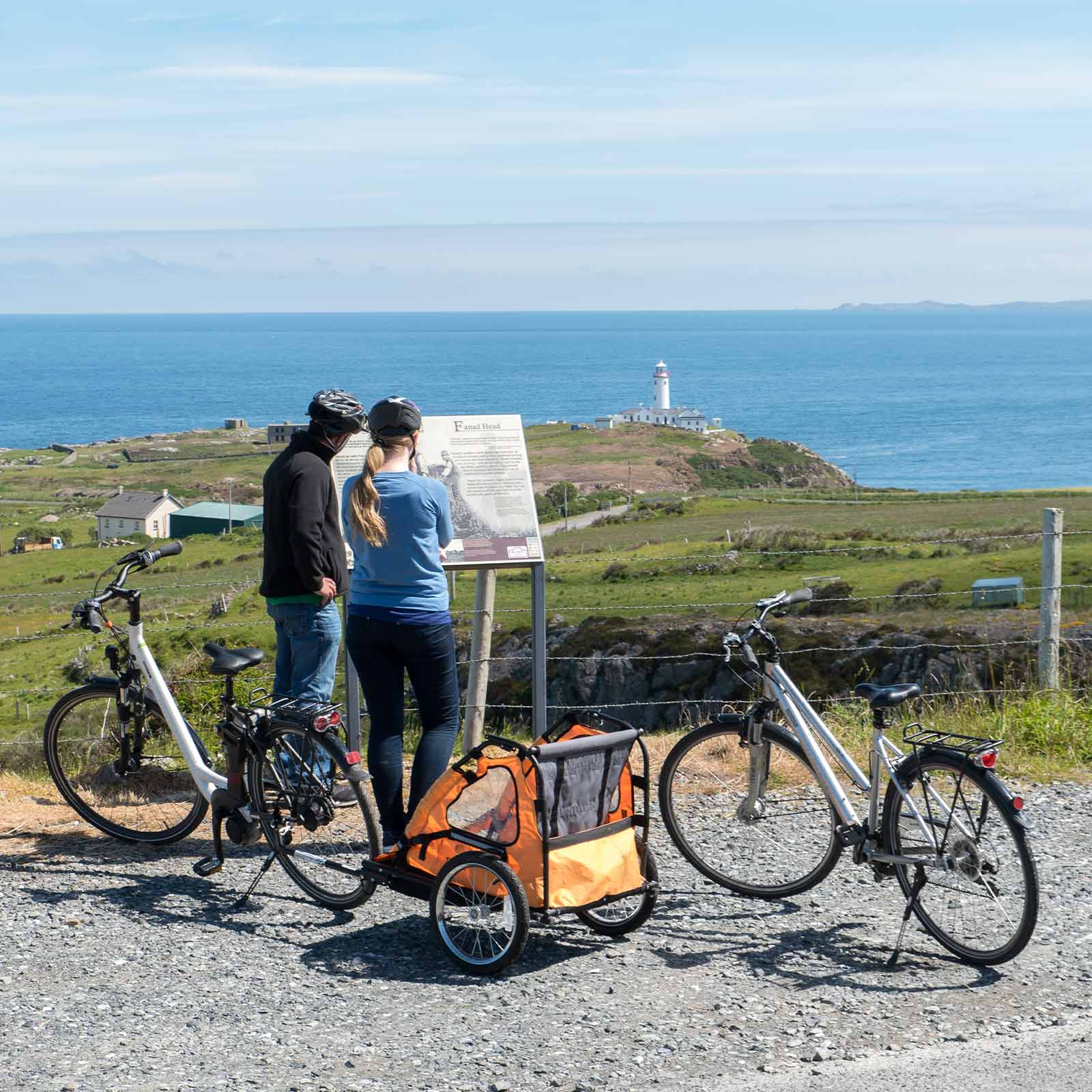 Image of a couple cycling near Fanad Lighthouse